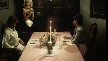 Vintage maid blows cocks under the table