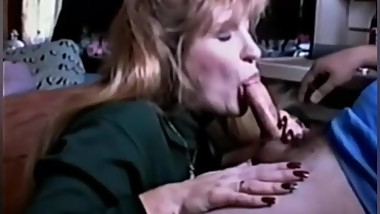 Vintage sexy Milf giving a sensual blow job to husband....