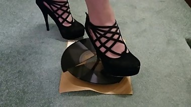 Agatha destroys a vintage 1940's record with gorgeous heels