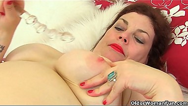 English milf Vintage Fox loves stripping off