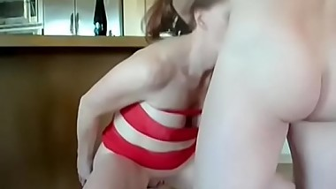 Lusty redhead toys her cunt before taking it in the ass