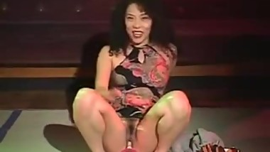 Japanese naked girl acrobat show on the stage