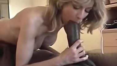 Excerpt of vintage movie: Wife sucks big black cock whilst hubby films.