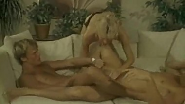 Tall blonde fingers herself then fucks in threesome in retro porn movie